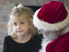 A 6-year-old at Toliver Elementary School in Danville, Ky., tells Santa Claus what she wants for Christmas.
