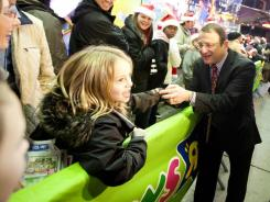 Toys 'R' Us CEO Jerry Storch greets Black Friday bargain hunters waiting in line outside the toy retailer's New York City store.