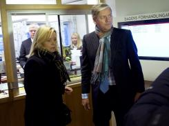 Saab's chief executive Victor Muller and car maker's lawyer Kristina Geers leave the offices of the court in Sweden, where the company filed for bankruptcy on Dec. 19, 2011.