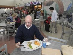Steve Wasser of Moline, Ill., eats in the food court in Detroit's Metropolitan Wayne County Airport.,  where all 59 restaurants offer at least one low -fat vegetarian option.