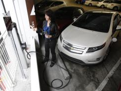 Shannon Arvizu lives in Venice Beach, Calif., but charges her car at Santa Monica Place shopping mall twice a week because there is no charger at her condo complex.