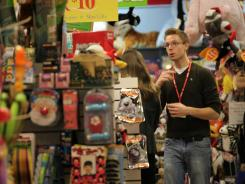 Taylor Holladay helps a customer at specialty toy retailer Razzmatazz Toys in Laurel Park Place mall in Livonia, Mich. in this Nov. 10 photo.