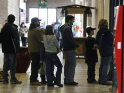 A line of shoppers bearing returns extends into the mall in Berlin, Vt., Dec. 26, 2008.