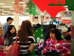 Shoppers browse through items on sale at a Target store in Rosemead, east of Los Angeles, on Nov. 25, 2011.