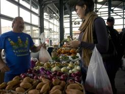 Fresh:  Carolyn Anderson talks to vendor Brian Ray at The City Market on Nov. 12 in Kansas City, Mo.