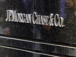 JPMorgan Chase and Bank of America Merrill Lynch were big players in syndicated loans to U.S. corporations this year.