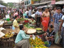 Fruit and vegetable vendors at the daily market in Twante, Burma, a 90-minute drive from Rangoon.