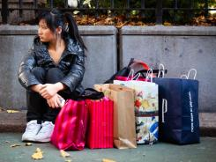 A shopper rests in New York's Herald Square during the busiest shopping day of the year, Nov. 25.