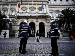 Policemen in front of the Bank of Italy in Rome on Dec. 16, 2011.