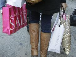A shopper on 34th Street in Manhattan, carrying the haul from a retail expedition in New York on Dec. 26, 2011.
