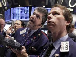 Traders on the floor of the New York Stock Exchange on Dec. 20, 2011.