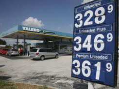 Motorists look for an empty pump at a Valero gas station in Miami Gardens, Fla., in this file photo.