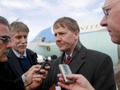 Richard Cordray talks with reporters Wednesday after stepping off Air Force One at Cleveland.