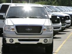 Ford F-150 pickup trucks at a dealership in Sterling Heights, Mich.
