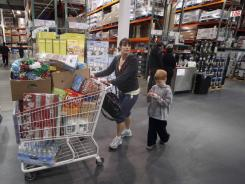 Jenni Weber and son Jacob, of Portland, shop at a Costco store, in early December.