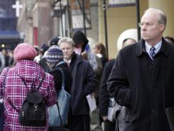 Stephen Rutkowski, a chiropractor from Greenwich, Conn., waits in line to attend a job fair in New York City.