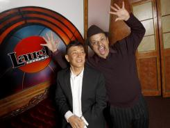 Jamie Masada, left, with comedian and Laugh Factory investor Paul Rodriguez, opened a new Laugh Factory site in Chicago. People turn to comedy during tough times, Masada said.