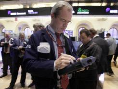 Trader David O'Day works on the floor of the New York Stock Exchange in December 2011.