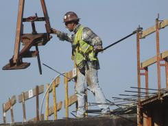 A construction worker at a new condo complex in Sunrise, Fla., on Jan. 5, 2012.