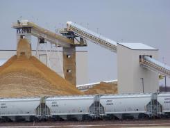 Frac sand destined for the oil and gas fields piles up at the EOG Resources processing plant in Chippewa Falls, Wis.