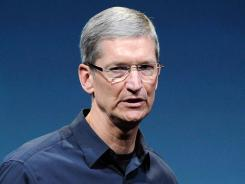 Apple CEO Tim Cook introduces the iPhone 4s in October.