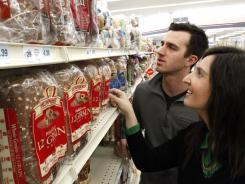 Kelsey and Eric Williams of Waukee, Iowa, look over the bread selection at a Hy-Vee grocery store in West Des Moines, Iowa.