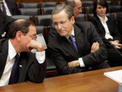 Fannie Mae CEO Michael Williams, center, before testifying before a House Financial Services subcommittee on Dec. 1.
