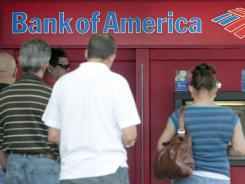 Customers in line at a  Bank of America ATM in Hialeah, Fla., in October 2011.