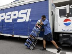 A Pepsi delivery worker delivers beverages in Pacifica, Calif.,