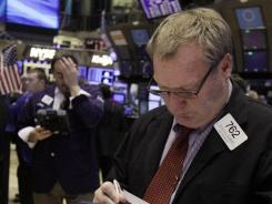 Trader Douglas Glander works on the floor of the New York Stock Exchange on Jan. 10, 2012. .