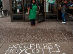 Graffiti outside the Starbucks Coffee at 15th & K Sts, Northwest in Washington,, where Occupy DC protesters use the bathroom, get free wi-fi and buy coffee.