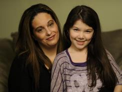 Jessica Fernandez, with daughter Isabella, has more than $35,000 in private student loans. Paying them back became a major issue when she was laid off two years ago.