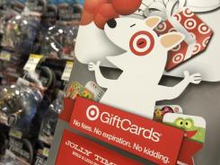 The Target mascot dog advertises gift cards at a Target store in Mayfield Hts., Ohio, in this file photo.