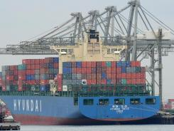 A container ship being unloaded in San Pedro Bay off the coast of Los Angeles and Long Beach, Calif. .