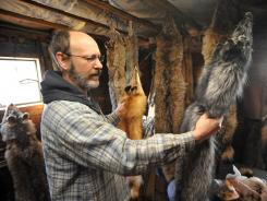 Kevin Syperda in his fur shed in Pierson, Mich.