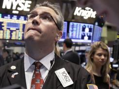 Trader Eric Schumacher works on the floor of the New York Stock Exchange in January 2012.