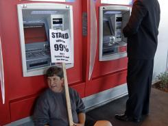 A protester at a Bank of America ATM in November in Oakland, Calif.