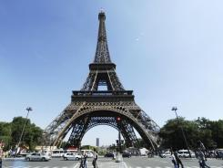 A wide-angle view of the Eiffel Tower in Paris.