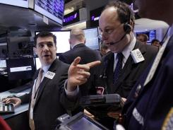 Traders and stock specialists on the floor of the New York Stock Exchange on Jan. 18, 2012. )