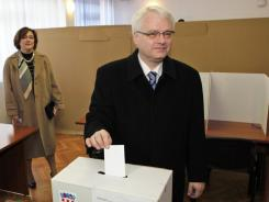 Croatian President Ivo Josipovic casts his ballot at a polling station in Zagreb on Sunday.