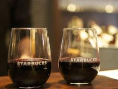 Wine sits at the wine bar in Starbucks branded glasses.