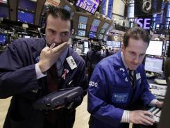 Traders and stock specialists work on the floor of the New York Stock Exchange on Jan. 18, 2012.