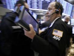 A trader rushes across the floor of the New York Stock Exchange on Jan. 18, 2012.