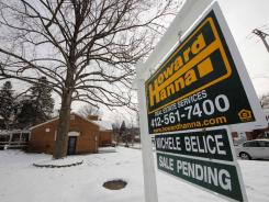 A home with a sale pending sign in Mount Lebanon, Pa., on Jan. 20, 2012.