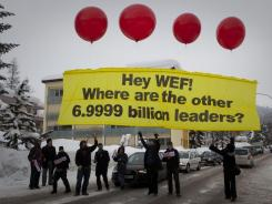 Protesters from the Occupy movement release a banner reading 'Hey WEF! Where are the other 6.9999 billion leaders?' at the 42nd annual World Economic Forum in Davos, Switzerland, Jan. 25, 2012.