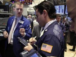 Stock specialists work at their post on the floor of the New York Stock Exchange on Jan. 18, 2012.