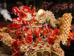 A dragon dance parade in Hong Kong celebrating the start of the Chinese New Year.