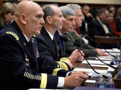 Armed services chiefs testify on the budget before the House Armed Services Committee in November 2011. Government spending cuts helped hold down GDP in 2011's fourth quarter.