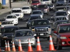Traffic at the entrance of State Route 85 in San Jose, Calif. on Jan. 12. In 2025, one in seven new cars sold will have to be an electric or other zero-emission vehicle.