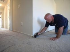 Carpet is installed in a home under construction in Live Oak, Calif.